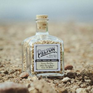 Pelton, a Mecca Grade Estate Malt product, in a display bottle.